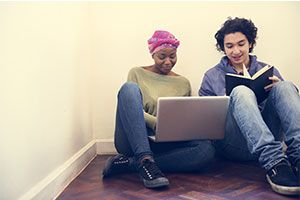 a pair of young people applying for a mortgage