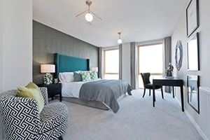 Grey bedroom in help to buy apartments at Parklands, Barking Riverside