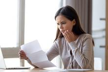 Young woman looking at declined mortgage application
